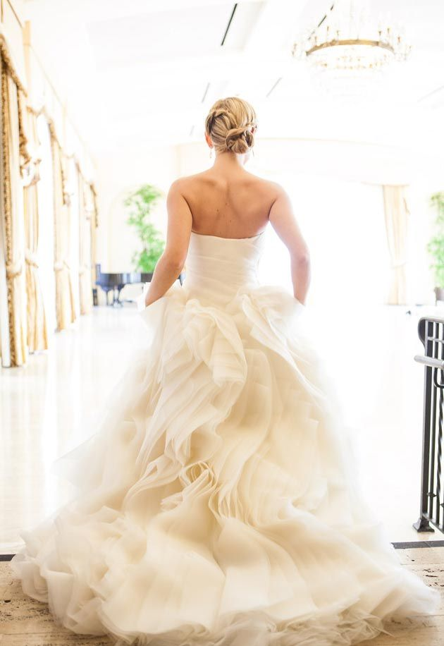 The bride's Vera Wang gown featured gathered panels of silk chiffon that…