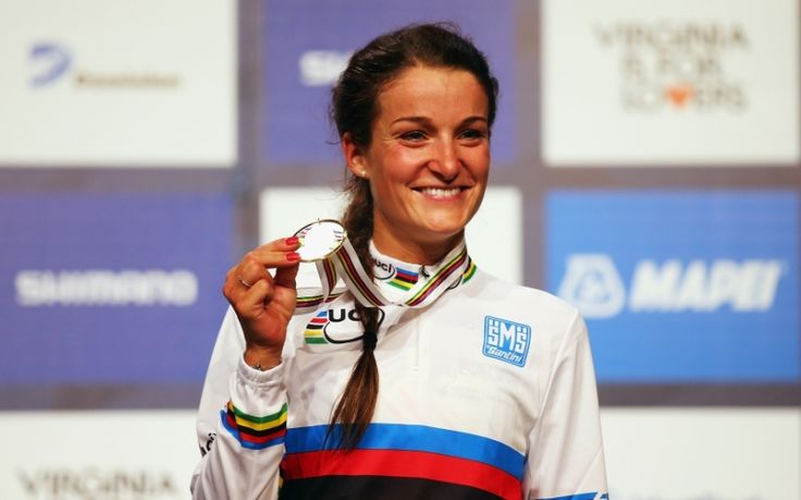 Lizzie Armitstead becomes only the fourth British woman ever to win the world   road race title, as preparations begin for the men's race on Sunday