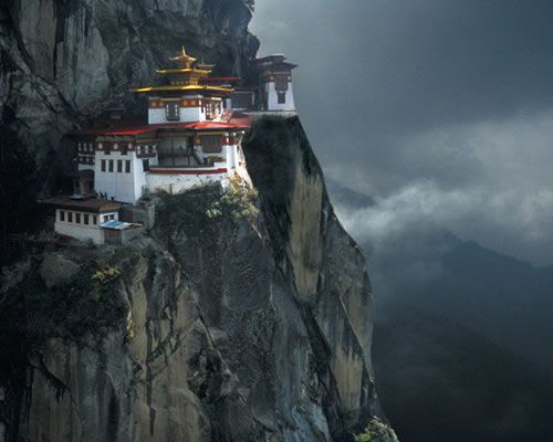 Tiger's Nest Monastery, perched precariously on the edge of a 3,000-feet-high cliff in Paro Valley, is one of the holiest places in Bhutan.: Tigernest, Tigers Nests, Temples, Built In, Bhutan, The Edge, Nests Monasteri, Travel, Places