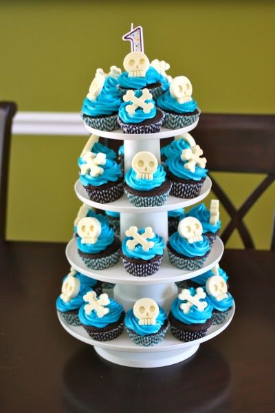 Cupcakes made by me.  Cake recipe | Frosting recipe | Chevron cupcake liners | Skull & Crossbones Mold