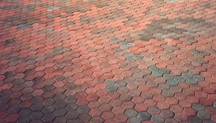 Gorgeous display of color! This Honeycomb paver in B4 (red/tan/charcoal) provides warmth and beauty to the installed area.