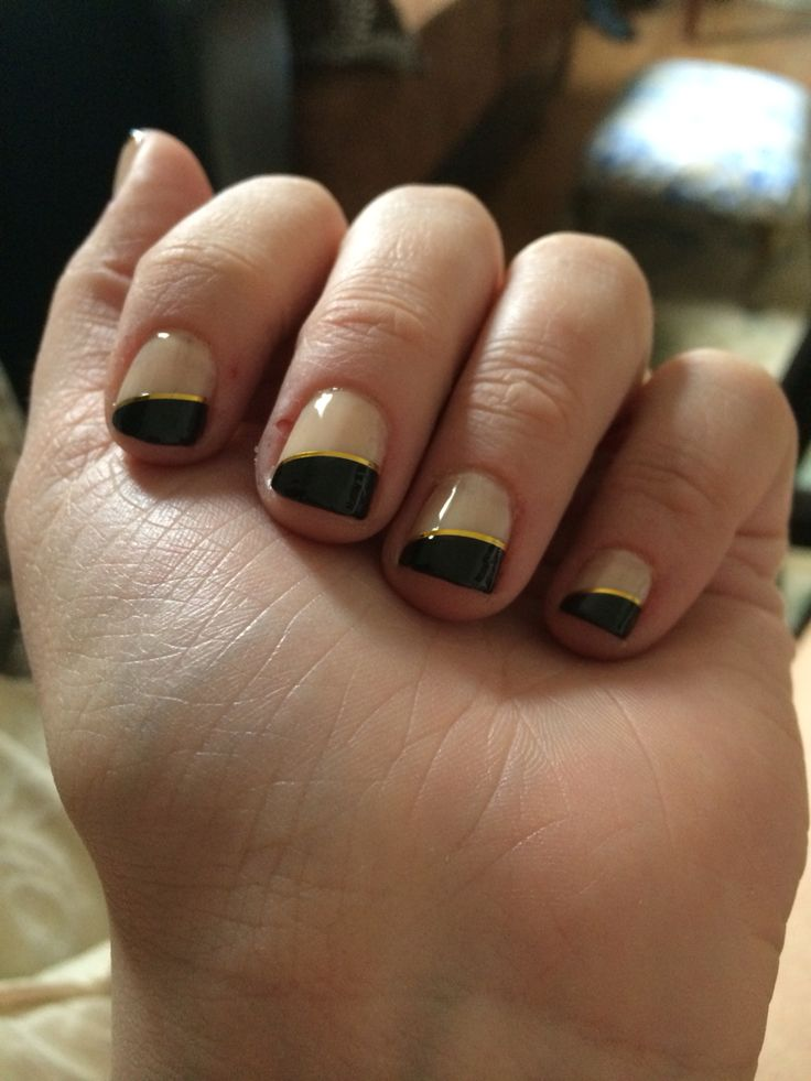 Angled French manicured nails with gold accent
