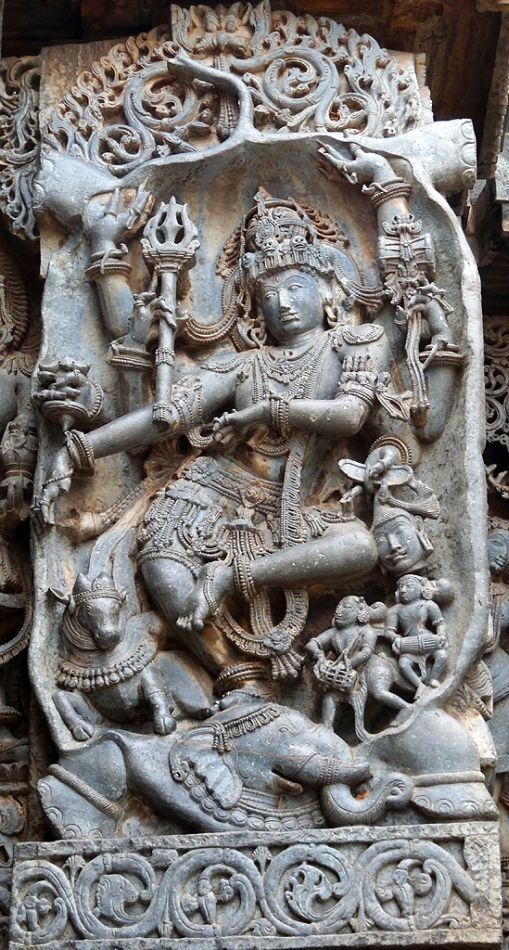 Gajasura Mardana. Lord Shiva, as Gajasura Mardana, is slaying Gajasura, the elephant demon by ripping him off from inside out. Observe the two legs and tail of the demon above Shiva's head.