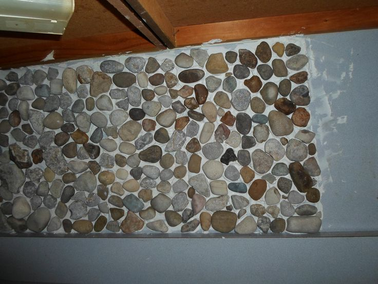 placing the rocks with tile mastic,I had to start at the bottem and work up.The weight of the rocks made them slide down.