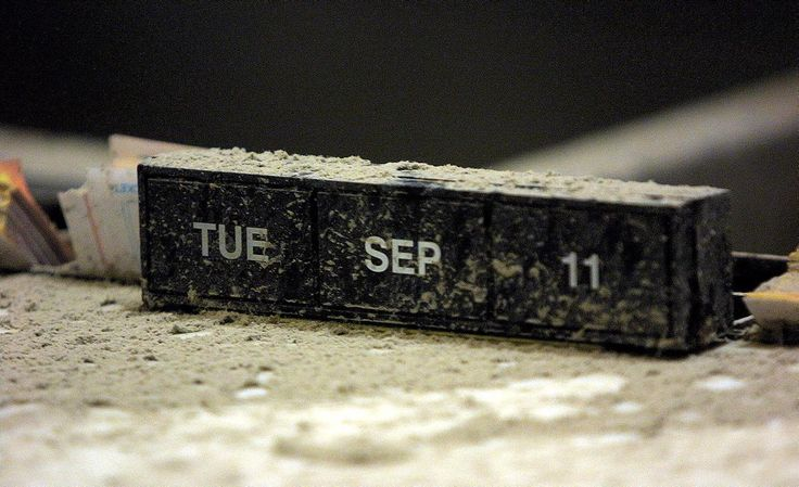The date of the terrorist attacks on the World Trade Center is shown on a calendar covered in ash on a counter at the Chase Manhattan bank on Broadway on Sept. 20, 2001, about a block from the World Trade Center site in New York.