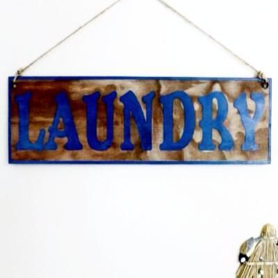 Custom made blue rustic laundry sign