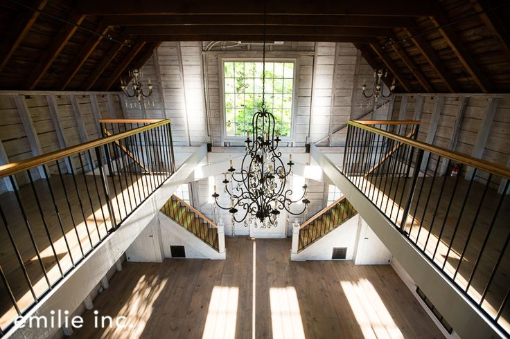 We love the contrast between rustic barn and sophisticated chandelier at the Barn at Hardy Farm. Photo by  Emilie Inc. www.realmaineweddings.com