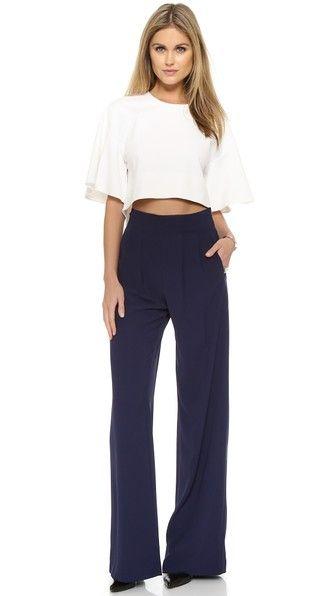 Parker pants with a high rise and wide legs. Crisp pleats accent the waist. Welt hip pockets. Hidden side zip.