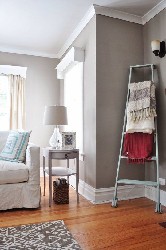 12 Decorating Ideas for Tricky Room Corners: 2. Balance a Tall Ladder: Beth used that weird space right inside her bungalow's front door for a tall ladder, which doubles as blanket storage.