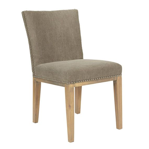 Elevate your dining room with our Beauvoir Dining Chair, upholstered in a hard-wearing cotton and jute blend fabric and edged with polished metal studs. Combine with our Villandry range of dining benches, sofas and corner units to create an extremely comfortable, bespoke dining seating area; or use solo as a desk or dressing table chair. Also pairs beautifully with our Villandry Dining Chairs. Upholstered in 37% cotton/63% jute with Birch wood legs. Available in either Heron Blue or Mush...