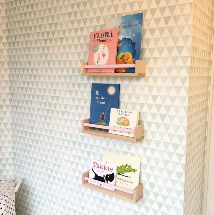 These BEKVÄM spice racks were repurposed as wall mounted bookshelves.                                                                                                                                                                                 More
