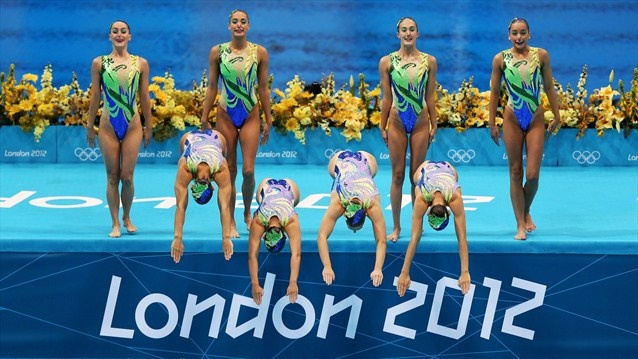 Great Britain enter the water  Great Britain competes in the Women's Teams Synchronised Swimming Free Routine final on Day 14.