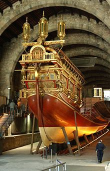 """The Real, built in Barcelona at the Royal Shipyard, was the largest galley of its time and the flagship of Don Juan de Austria in the Battle of Lepanto in 1571, the largest battle between galleys in history, in which a fleet of the Holy League, an alliance of Christian powers of the Mediterranean, decisively defeated an Ottoman fleet under Grand Admiral (""""Kaptan-ı Derya"""") Müezzinzade Ali Pasha"""
