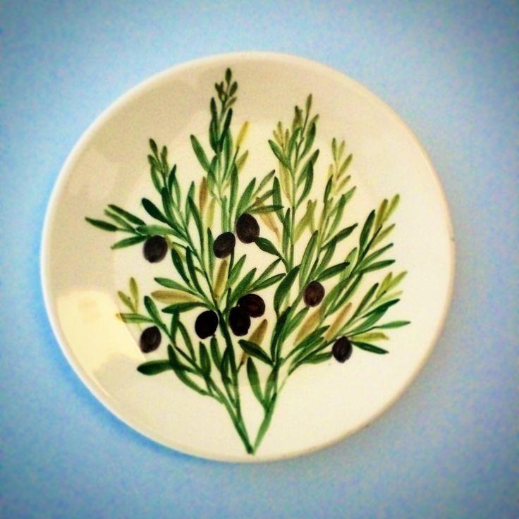 "Hand-painted decorative plate, hanging on the wall of ""Elia"" room.   #handpainted #decoration #olive #eleonashotel #travel #greece #greekart"