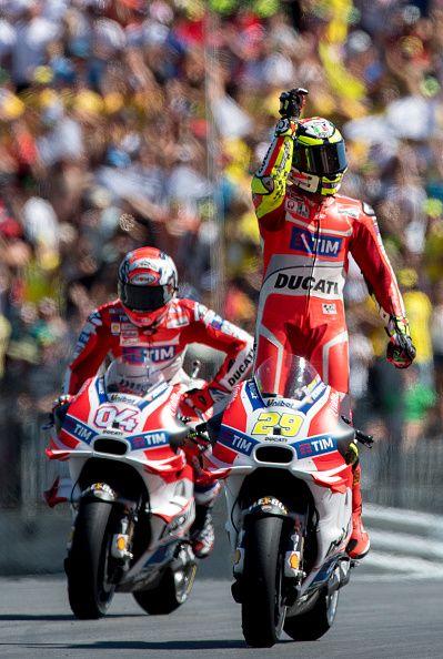 The winner Italian rider Andrea Iannone of Ducati Team and second placed Italian…