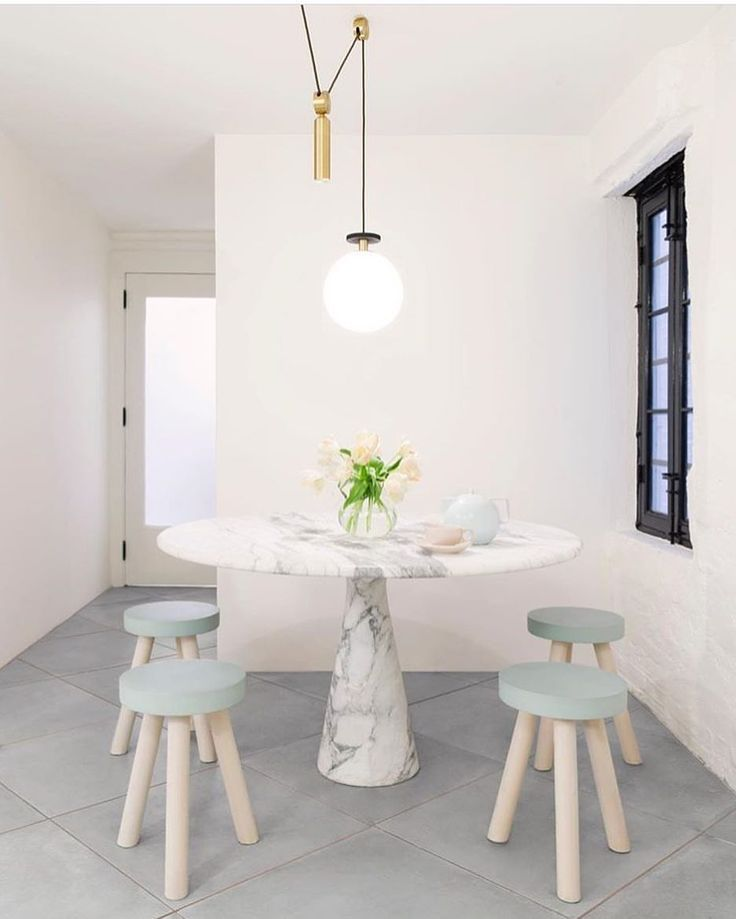 A soft and contemporary dining space complete with marble table • thewhitearrow •