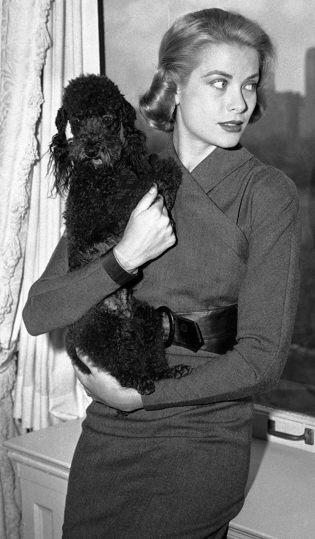 March 30, 1956: Grace Kelly and her pet, French poodle Oliver, make a homey two some at her New York apartment