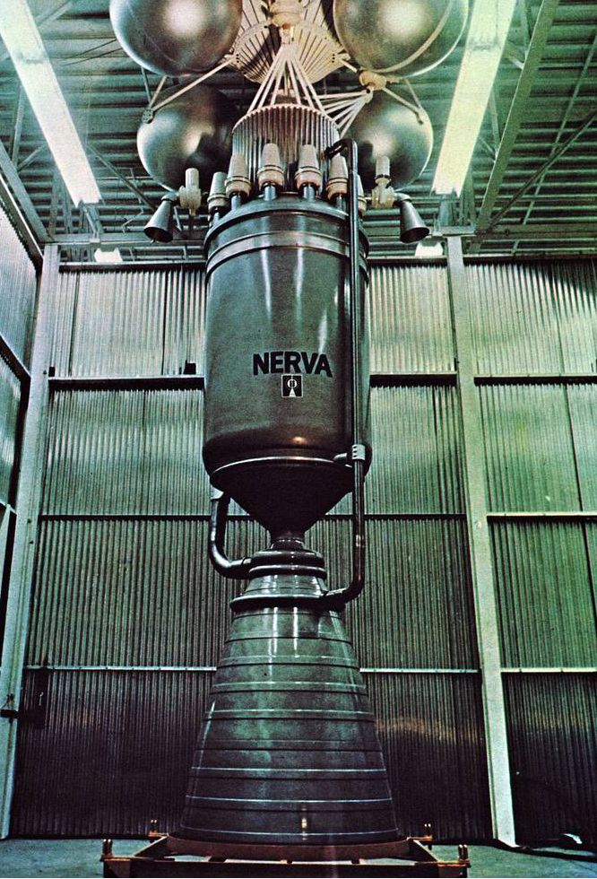 Mockup of a NERVA nuclear rocket engine. The drum-shaped pressure vessel bearing the NERVA label represents the nuclear reactor, on top of which is mounted the shadow shield for reducing crew radiation exposure. Image: Atomic Energy Commission