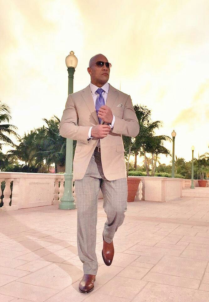 Dwayne Johnson in a well tailored suit, grown man style