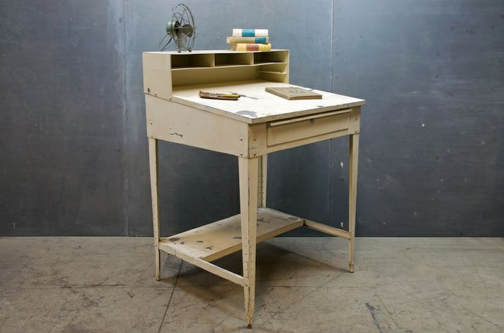 Vintage Industrial Steel Foreman's/Captain Desk. Heavy Steel construction with upper storage dividers and large sliding front drawer. Time worn patina white finish. NY, c.1960.