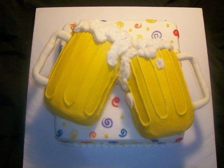 all buttercream icing except mmf handles. Made this for a birthday, they wanted 2 beer mugs toating or Cheers as I call it. It ended up sayi...
