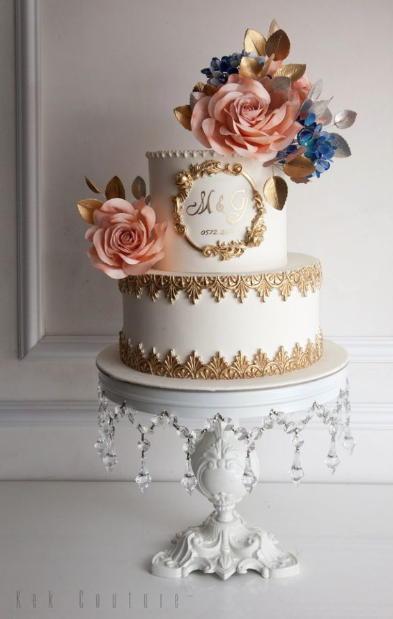 Featured Cake: Kek Couture; Chic two tier gold detail white wedding cake topped with pink flowers