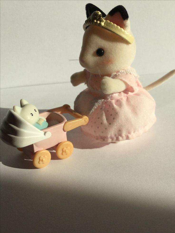 Primrose pushing her toy pram