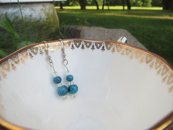 Delicate dangle earrings with beautiful detailed plastic beads with a touch of glass seed beads and glass crystal cut beads. This color of blue is truly amazing and absolutely stunning!  These dangle earrings use hooks with no backs. $11