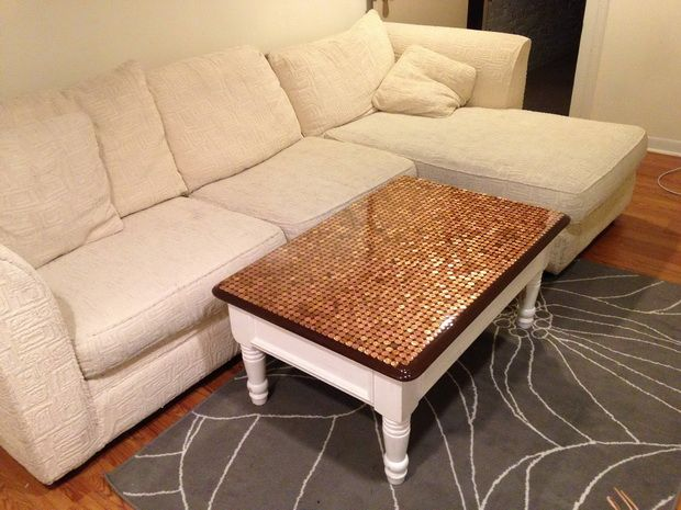 Here is our very unique DIY Coffee Table with a 2000 penny top COMPLETED and in our living room all for under $50 bucks!