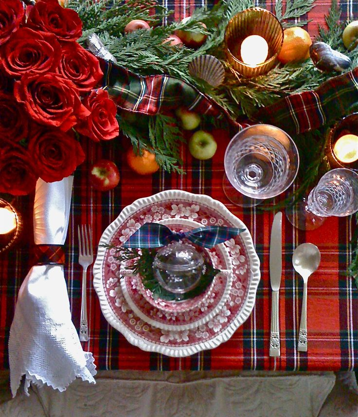 Cluster of roses, greenery, fruit and plaid - could be a plaid blanket - and pretty white napkins