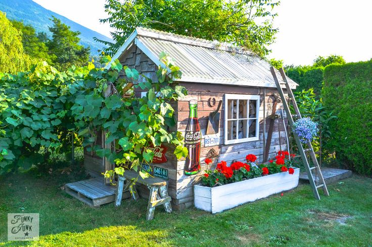 Adorable little rustic garden shed was transformed from with reclaimed wood and junk. See how at  Funky Junk Interiors (scroll down for all the how-tos.)
