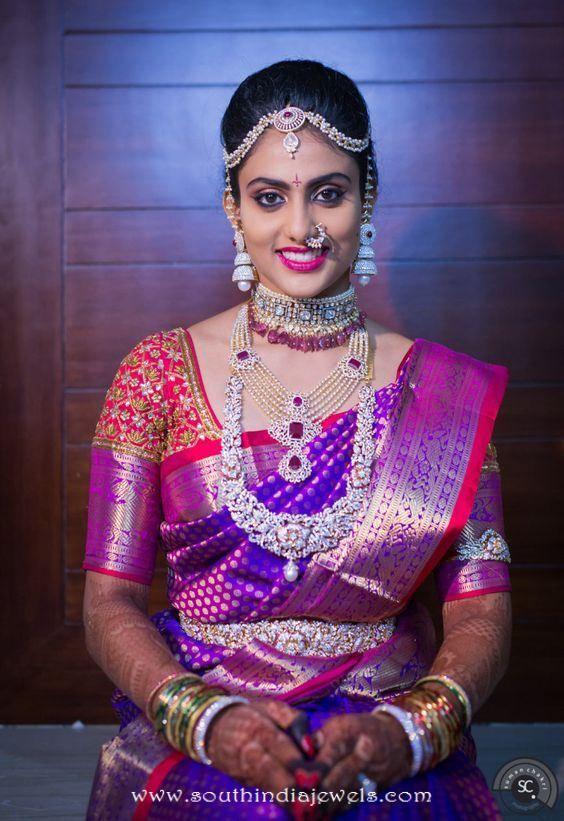 Stunning south indian bride wearing Diamond choker, medium length necklace, long necklace, tikka, jhumka, nosepin and bangles.