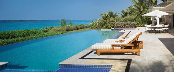Lounge poolside at a private villa in the Bahamas. One & Only Ocean Club.