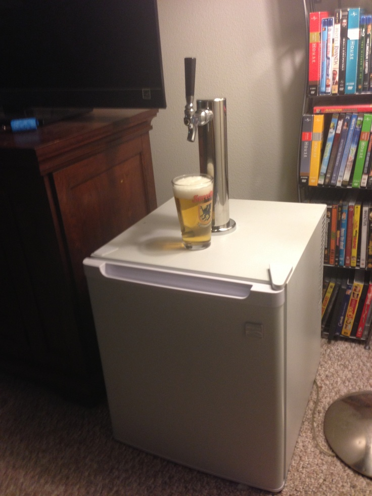 $75 Homemade mini kegerator built using $15 Kenmore (clearance) mini fridge  and a $50 eBay beer faucet . Uses Heineken mini kegs.