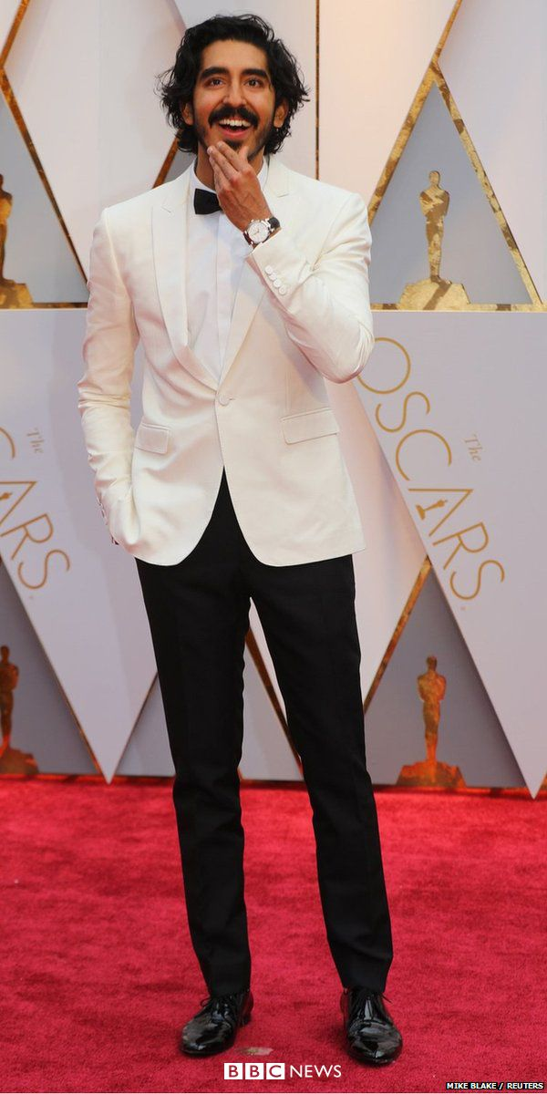 Oscar nominee Dev Patel was flying the flag for the British - and he chose definitive British brand Burberry for his Oscars look.