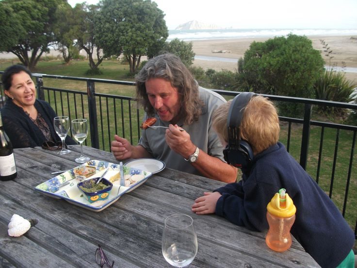 Brother Craig eating a good old kiwi sausage with Olivia and Ethan watching