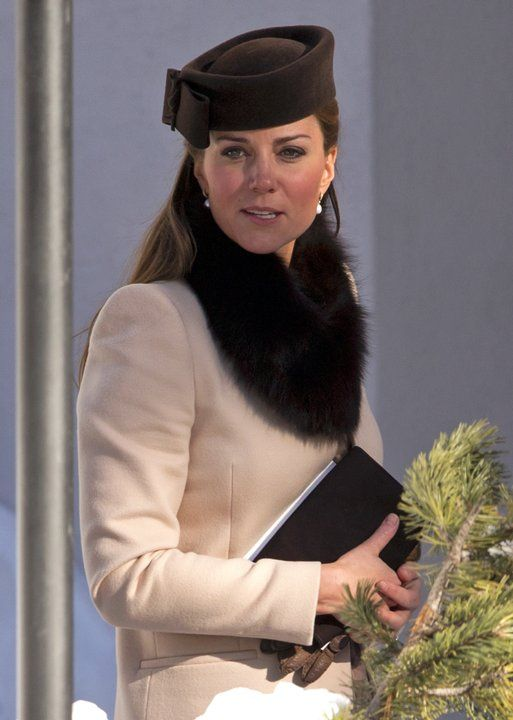 Kate Middletons Tiny Purse Collection | Photo Gallery - Yahoo! Shine Photo by: Getty Images  While attending the wedding of pals Olympic medalist Laura Bechtolsheimer and polo player Mark Tomlinson on March 2, 2013, Middleton carried a Natasha bag in chocolate suede with leather trim ($357).