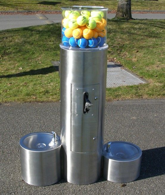 The back side of this custom dog water fountain has a waste bag dispenser for life's little accidents. ;)