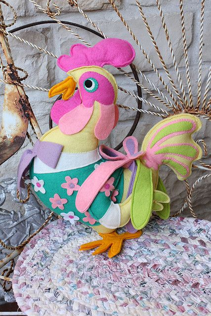 This dapper rooster is made of pieced felt and is finished the same on both sides. He is a handmade vintage find from a thrift store in Louisiana. He is ready to woo the chicks!