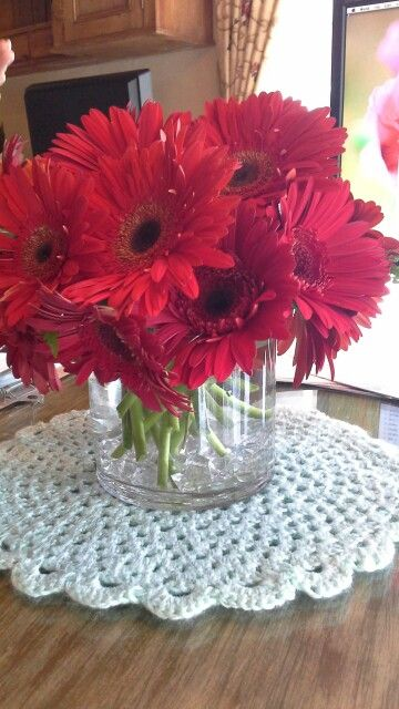 Sample of our centerpieces red gerbera daisies with mint