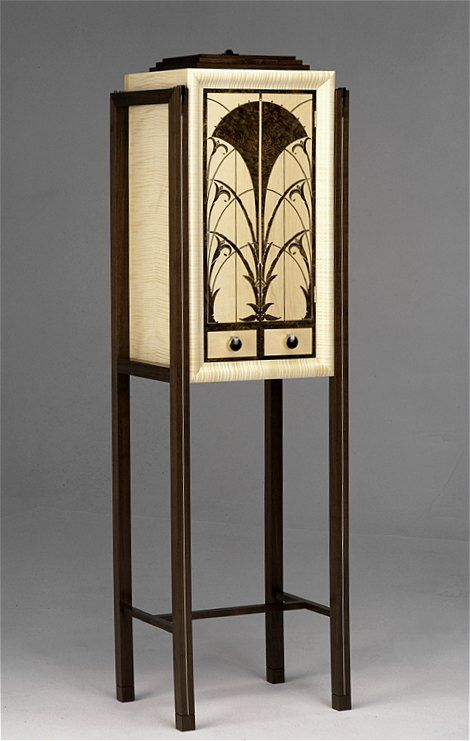 An 'Art Deco' inspired drinks cabinet, with two drawers, in black burr walnut and fiddle back sycamore.