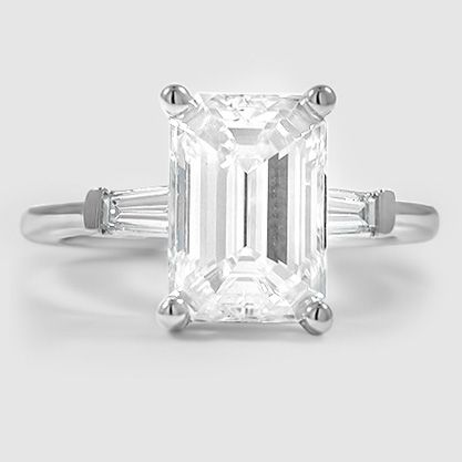 Our Tapered Baguette Diamond Ring set with a 2.70 carat emerald cut diamond…