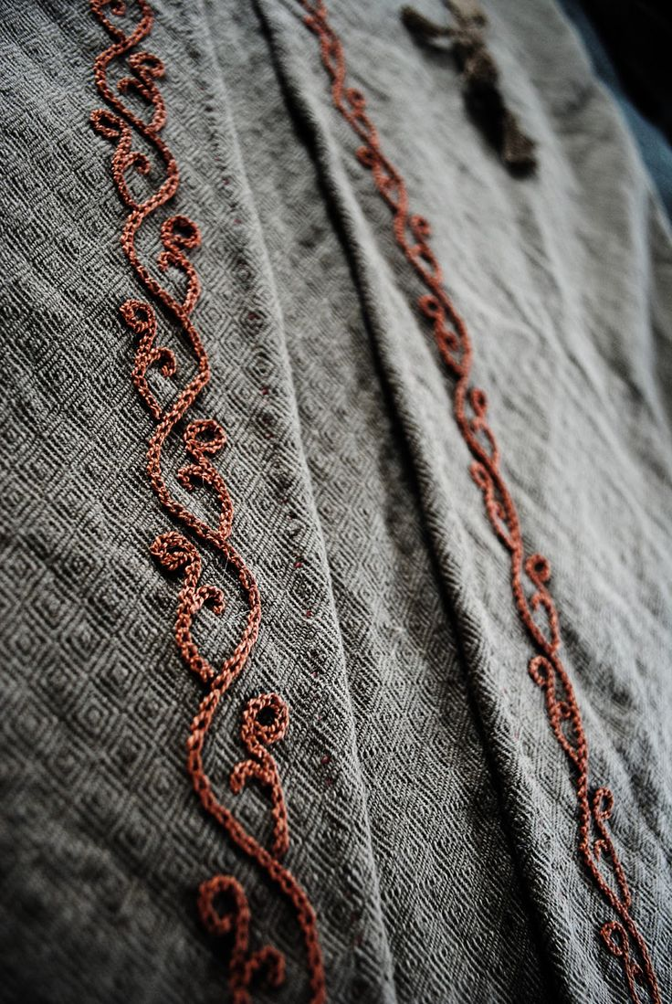viking handcraft, gorgeous embroidery detail in chain stitch. OoOOoOo! I'd love to sew this into a costume someday! So pretty!