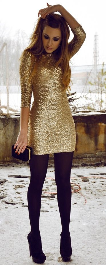 Sparkly gold party dress with black stockings and heels