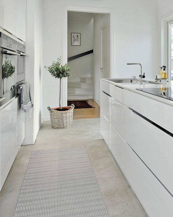 #39. White contemporary kitchen with island.