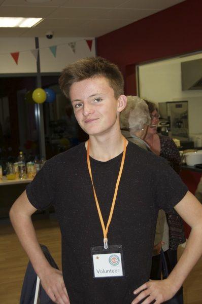 One of our young volunteers James (proud of his volunteer's badge) - CringlefordHub
