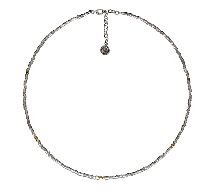 Unique to the Kamari Collection, this Sterling Silver necklace is crafted with tubular Chaquira beads and five 18K Gold stations. The Chaquira beads were once used by ancient Peruvians in their ceremonial attire and denoted nobility. A necklace fit for a queen is exclusive to Kamari Silver Jewelry. #silver jewelry #silver necklace