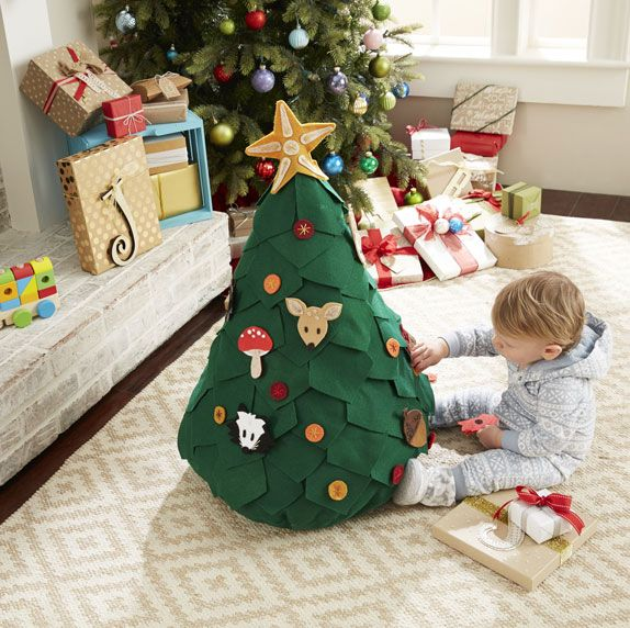 """Playtime Children's Tree.  So easy to eyeball!  Make a cone shaped pillow, attach some """"leaf"""" felt panels, then cut out ornaments from felt for a 3D felt board, essentially.  Love it!"""