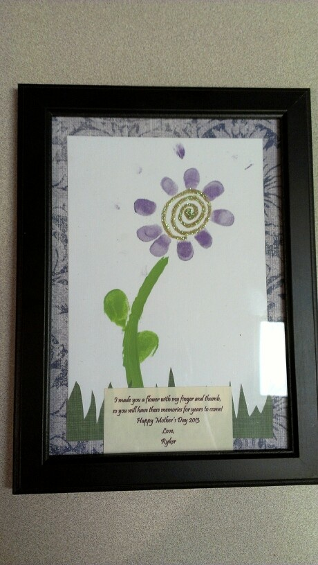 """Our Mother's Day toddler craft. Reads, """"I made you a flower with my finger and thumb so you can have these memories for years to come"""""""