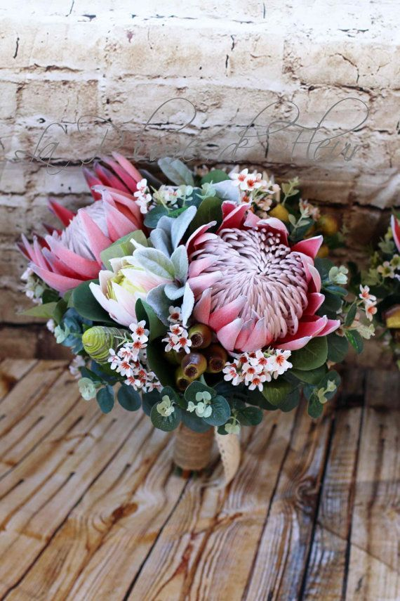Rustic bridal bouquet, bridesmaid bouquet.  King proteas, pink ice protea, Geraldton wax, gumnuts and Australian native foliage.